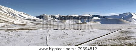 Panoramic View Of Snowy Plateau Of Castelluccio Of Norcia, In Umbria,