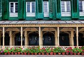 King palace museum with picture gallery green windows and flower pots on Durbar square in Kathmandu Nepal poster