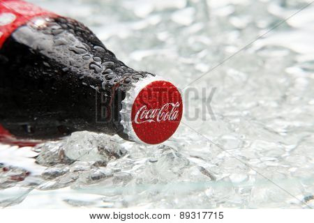kuala Lumpur,Malaysia 15th April 2015,Editorial photo of Classic Coca-Cola Bottle in crushed ice.