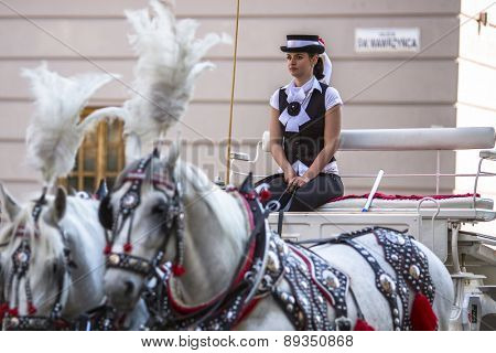 KRAKOW, POLAND - APR 25, 2015: Old-styled carriage for tourists in the Main square of Old Krakow. Krakow is visited by over 8 million tourists a year, number of foreign tourists up to 2 million people