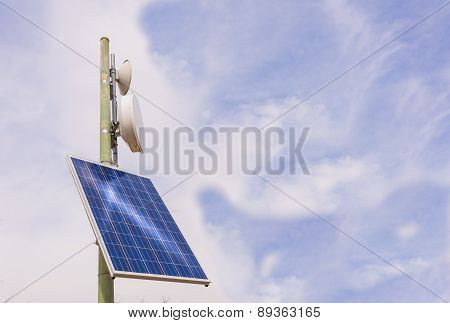 Small antenna booster with solar panel in the mountains poster