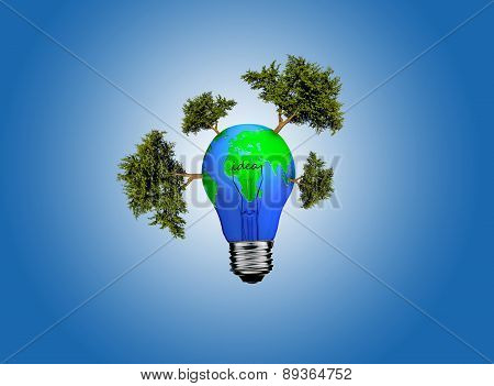 Earth In Light Bulb On A Blue Background