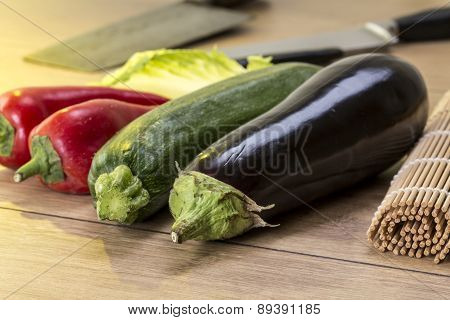 Still Life With Eggplant, Zucchini And Red Bellpepper