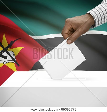 Ballot Box With National Flag On Background - Mozambique
