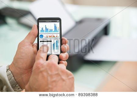 Person Using Cellphone For Printing