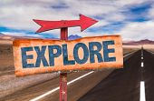 Explore sign with road background poster