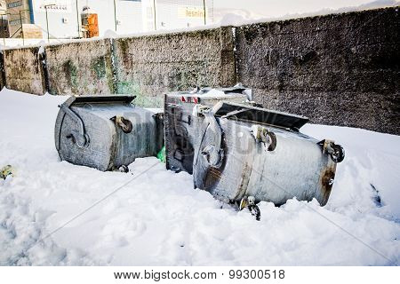 Overturned Garbage Containers During Strong And Snowy Winter