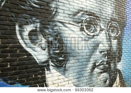Graffiti On A Wall With A Portrait Of Franz Schubert.