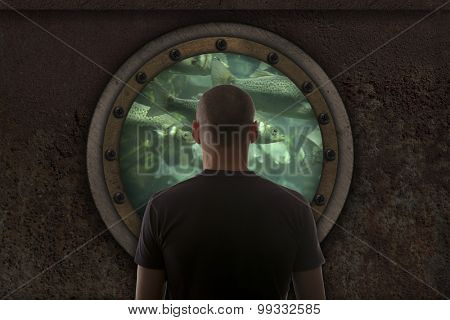 Captain looks out the window of the submarine