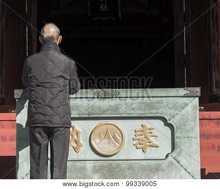 Prayer At Senjoji Temple Japan
