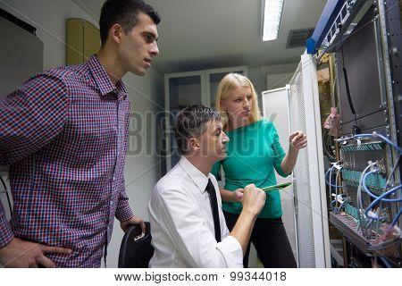 business people group, network engeneers working in network server room on tablet computer