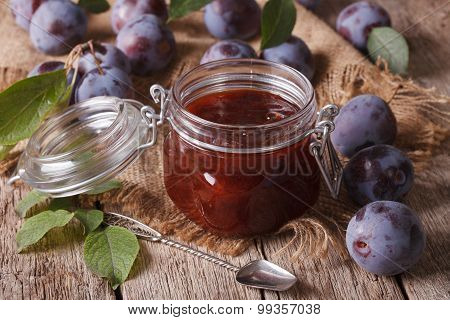 Sweet Plum Marmalade In A Glass Jar On The Table Close-up