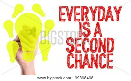 Hand with marker writing the word Everyday Is A Second Chance