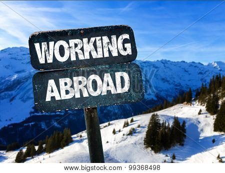 Working Abroad sign with alps on background