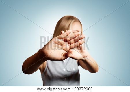 Closeup Portrait Distrust Young Portrait Of Blonde Woman Which Closes Hand From The Camera And Doesn