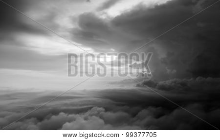 aerial view of the stormy sky with clouds from jet flight poster