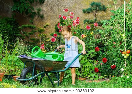 Cute little girl gardening in the backyard. Childhood concept. poster