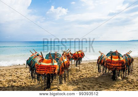 Many lifejacket placed on the beach and the coast