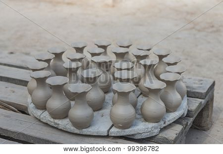 The Group Of Wet Pottery Vase Dry Under The Sun