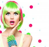 Surprised Beauty Fashion Model Girl with Colorful Dyed Hair, nails. Haircut with fringe. Colourful short Hair. Portrait of Beautiful Girl with Dyed Hair, professional hair Coloring. Colouring hair  poster
