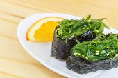 Traditional japanese food Chuka Wakame seaweed salad on wooden table poster