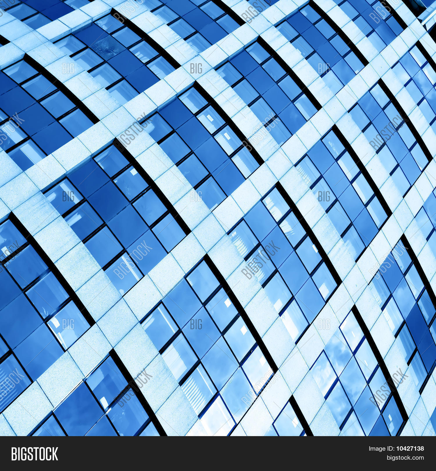 Abstract Blue Glass Texture Of Skyscrapers At Night