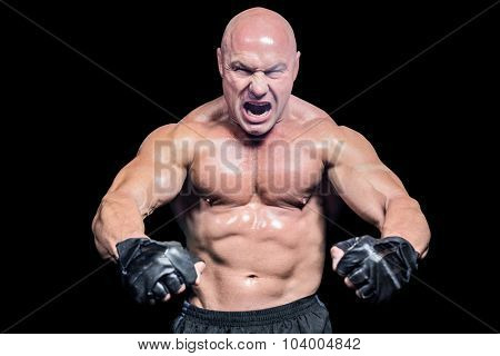 Aggressive fighter flexing muscles against black background poster