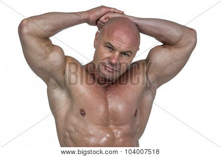 Portrait of bodybuilder with hands behind head against white background poster