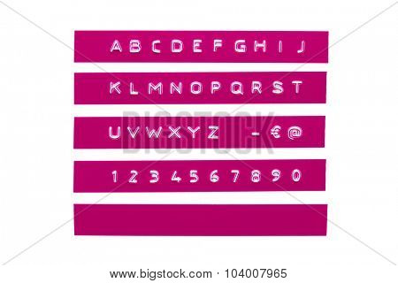 Embossed alphabet on purple plastic tape