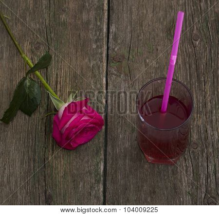 One Red Rose And Glass Of Juice, On An Old Table