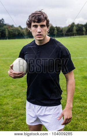 Rugby player scowling at camera at the park