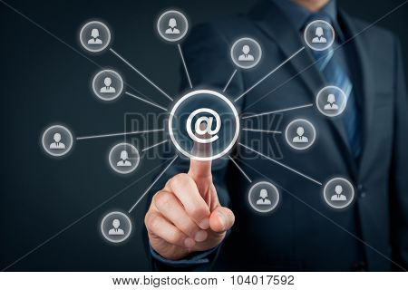 Email marketing newsletter and bulk mail concepts. Businessman click on button with at sign linked with people icons. poster
