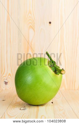 Coconut Balls Placed On A Wooden Floor.