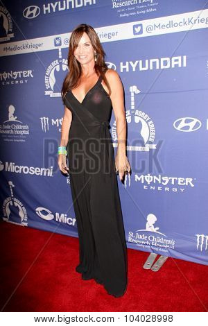 MOORPARK, CA - OCT 5: Debbe Dunning arrives at the 8th Annual Medlock/Krieger Invitational Golf Concert at the Moorpark Country Club in Moorpark, CA on October 5, 2015.