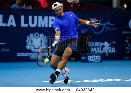 KUALA LUMPUR, MALAYSIA - SEPTEMBER 30, 2015: Satsuma Ito of Japan hits a forehand return in his match at the Malaysian Open 2015 Tennis tournament held at the Putra Stadium, Malaysia.