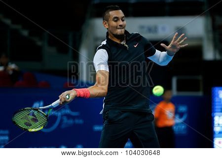 KUALA LUMPUR, MALAYSIA - SEPTEMBER 30, 2015: Nick Kyrgios of Australia attempts a forehand return in his match at the Malaysian Open 2015 Tennis tournament held at the Putra Stadium, Malaysia.