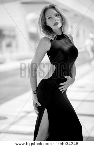 Sexy Elegant Woman Posing in Black Dress at Malaga Harbour Scenery