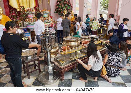 People burn candles in Nakhom Pathom cheri, Nakhom Pathom Thailand.