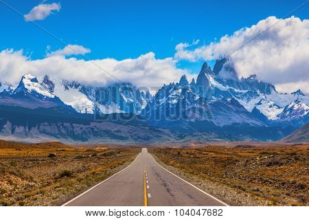 The road through the desert. The highway crosses the Patagonia and leads to the mountains Fitz Roy