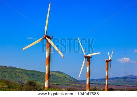 Israel. Some huge modern windmills. The blossoming Golan heights in a sunny day