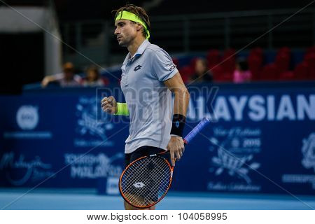 KUALA LUMPUR, MALAYSIA - OCTOBER 01, 2015: David Ferrer of Spain reacts after scoring a point in his match at the Malaysian Open 2015 Tennis tournament held at the Putra Stadium, Malaysia.