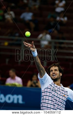 KUALA LUMPUR, MALAYSIA - OCTOBER 01, 2015: Feliciano Lopez of Spain tosses the ball to serve during his match at the Malaysian Open 2015 Tennis tournament held at the Putra Stadium, Malaysia.