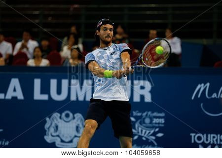 KUALA LUMPUR, MALAYSIA - OCTOBER 01, 2015: Joao Sousa of Portugal hits a backhand return during his match at the Malaysian Open 2015 Tennis tournament held at the Putra Stadium, Malaysia.