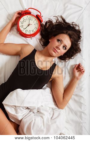 Sexy Lazy Girl Lying With Red Alarm Clock On Bed
