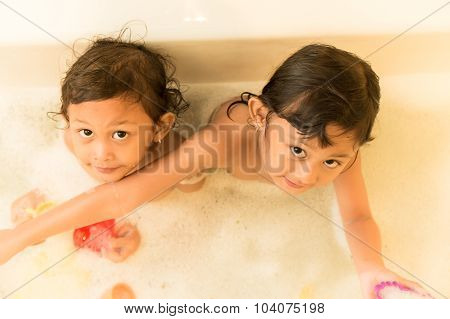 Asian Children Happy Playing In The Bathtub
