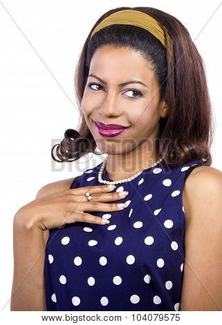 woman in polka dot blue dress looks shy and flattered poster