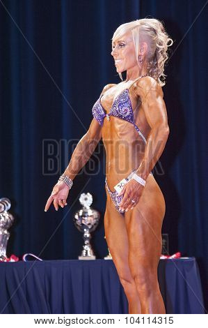 Female Bikini Contestant Shows Het Best Front Pose On Stage