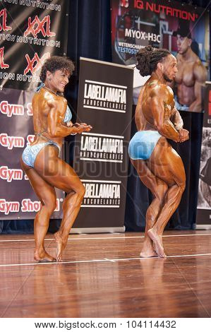 Bodybuilding Duo In Chest Pose On Stage
