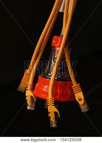 Hanging orange and clear industrial 240V power and several yellow data plugs