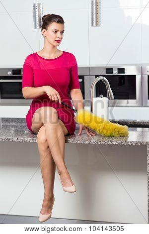 Lonely perfect housewife is sitting on countertop poster